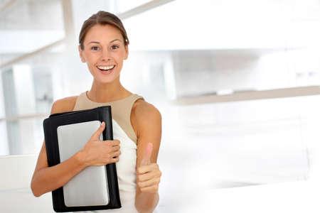 saleswomen: Cheerful businesswoman showing thumb up