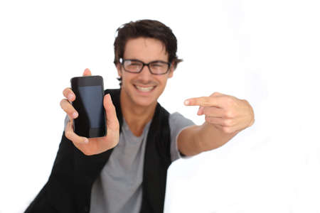 Young man showing smartphone screen to camera photo