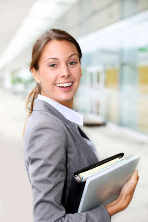 Portrait of beautiful businesswoman standing outside building photo