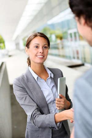 shaking hands business: Businesswoman shaking hand to partner Stock Photo