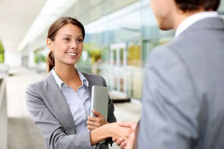 Businesswoman shaking hand to partner Stock Photo