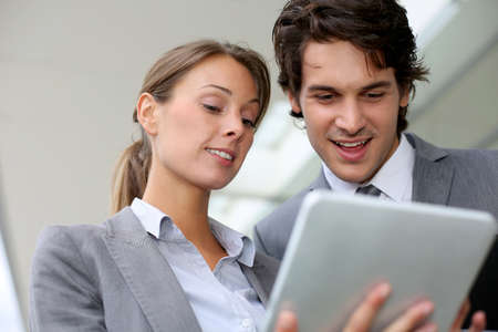 fair woman: Business partners meeting outside building Stock Photo