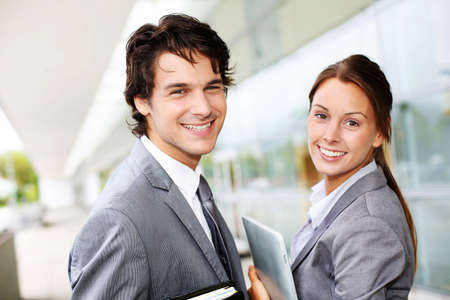 saleswoman: Successful business team standing outside