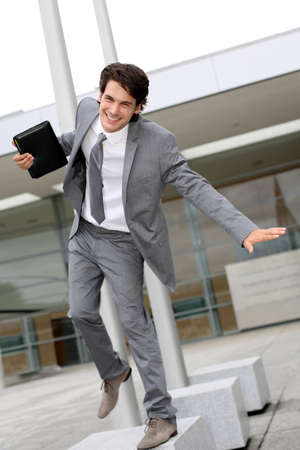 businessman jumping: Happy successful businessman jumping in the air Stock Photo