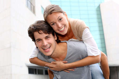 25 years old: Man giving piggyback ride to girlfriend