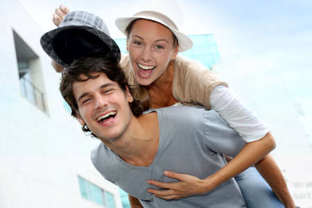 Man giving piggyback ride to girlfriend photo