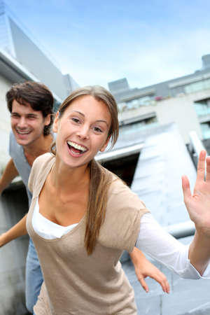 a young old couple: Young people having fun in college campus Stock Photo
