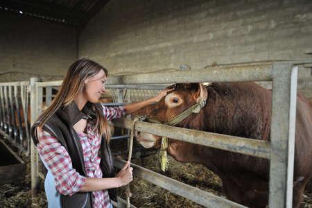 Portrait of woman working in barn photo