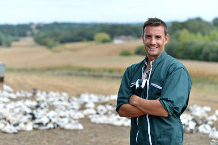 Duck breeder standing outside the farm Stock Photo