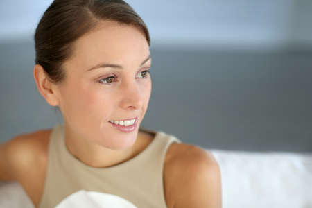 Portrait of attractive woman sitting in couch Stock Photo - 15611101