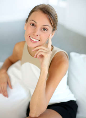 30 years old woman: Attractive woman with hand on chin looking at camera Stock Photo