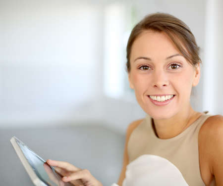 hair tied: Portrait of beautiful woman using tablet Stock Photo
