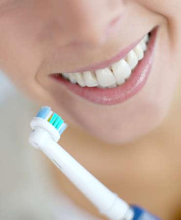 toothbrush: Closeup on womans teeth Stock Photo
