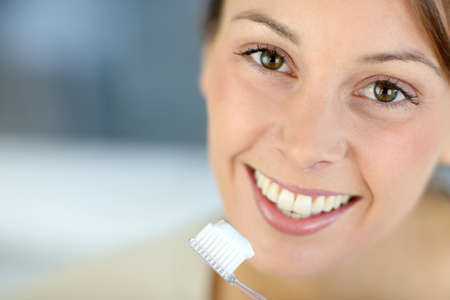 bodypart: Closeup on womans toothy smile brushing her teeth