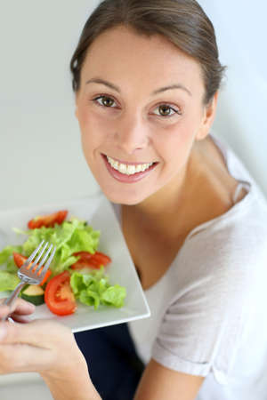 Closeup of cheerful woman eating fresh salad Stock Photo - 15638026
