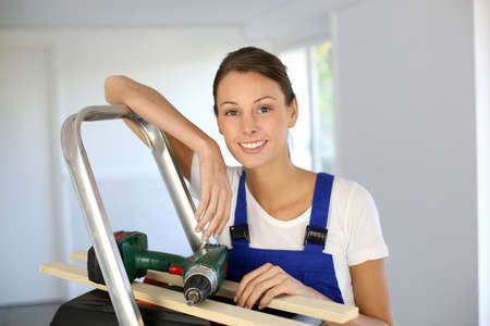 reforming: Cheerful young woman ready to reform house Stock Photo