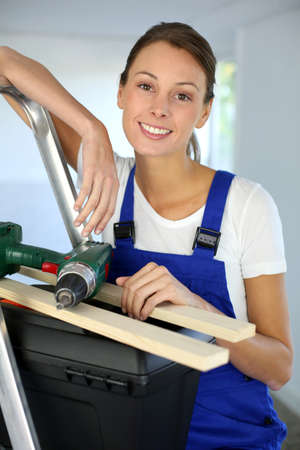Cheerful young woman ready to reform house Stock Photo - 15638030