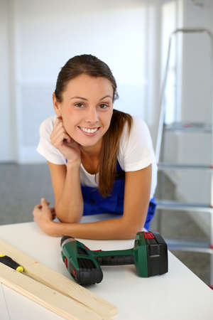Smiling woman ready to redo home Stock Photo - 15611292