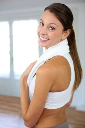 Portrait of cheerful woman exercising in gym photo