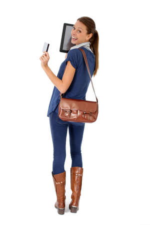 Shopping girl using tablet and credit card