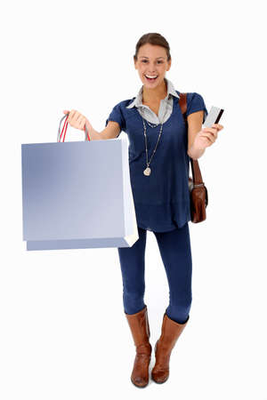 Trendy young girl holding shopping  bags, isolated photo