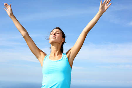 breathing exercise: woman doing yoga exercises in countryside Stock Photo