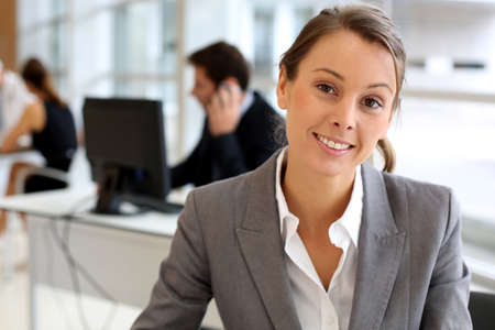 Portrait of attractive businesswoman sitting in office Stock Photo - 15811149
