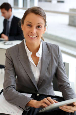 Businesswoman using electronic tablet Stock Photo - 15811226