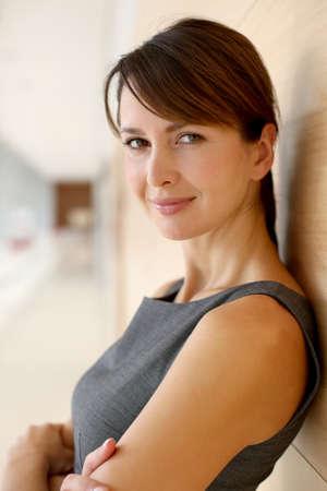sophisticated: Portrait of elegant businesswoman standing in hallway Stock Photo