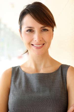 secretary woman: Portrait of elegant businesswoman standing in hallway Stock Photo