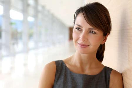 businesswoman standing: Portrait of elegant businesswoman standing in hallway Stock Photo