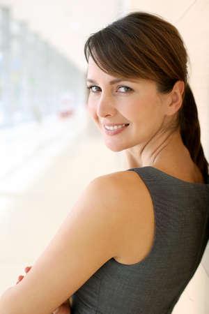 Portrait of elegant businesswoman standing in hallway photo