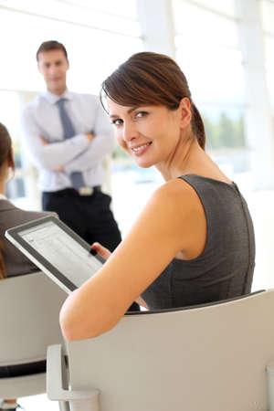 training consultant: Businesswoman attending business presentation