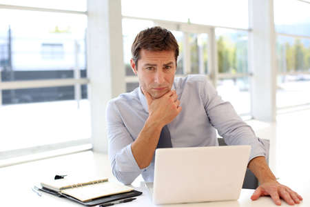 preoccupied: Businessman at work with preoccupied look