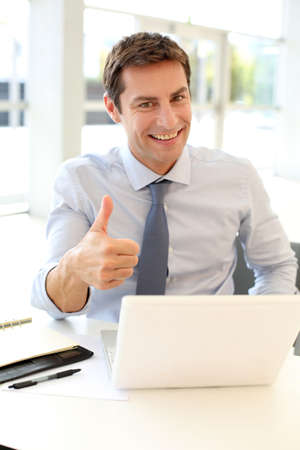 job satisfaction: Businessman showing thumb up Stock Photo