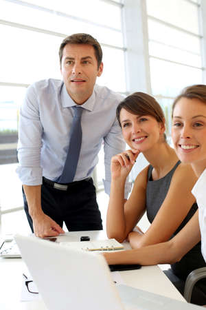 Business people looking at business plan on board Stock Photo - 15811131