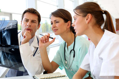 Medical team checking on X-ray results Reklamní fotografie