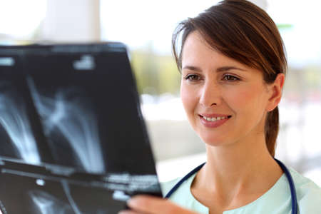 Nurse looking at X-ray results Stock Photo - 15811289