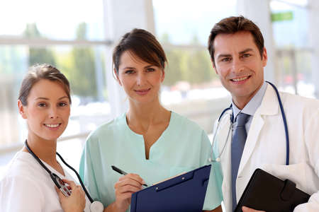 Smiling medical team standing in hall Stock Photo - 15811329