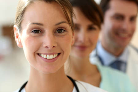 therapist: Smiling medical team in uniform Stock Photo