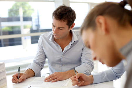 contractual: Business partners signing contractual documents Stock Photo