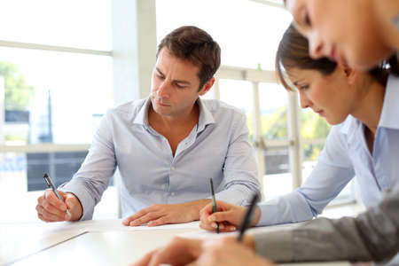 business writing: Business partners signing contractual documents Stock Photo