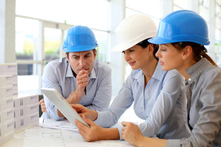 project manager: Architects working in office on construction project Stock Photo