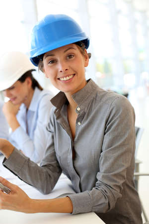 architect office: Architect with security helmet using electronic tablet Stock Photo
