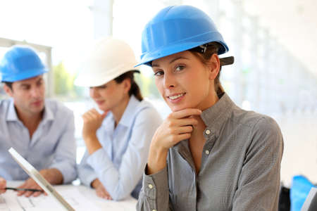 blue helmet: Architect with security helmet using electronic tablet Stock Photo