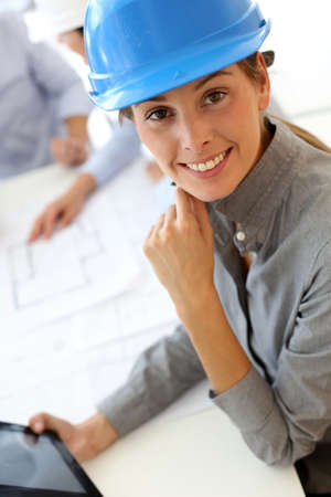 Architect with security helmet using electronic tablet Stock Photo - 15811269