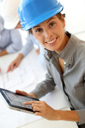 Architect with security helmet using electronic tablet Stock Photo
