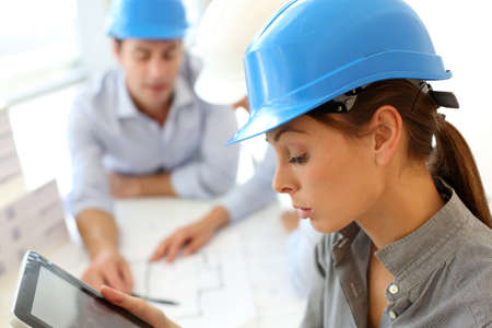Architect with security helmet using electronic tablet Stock Photo - 15811332