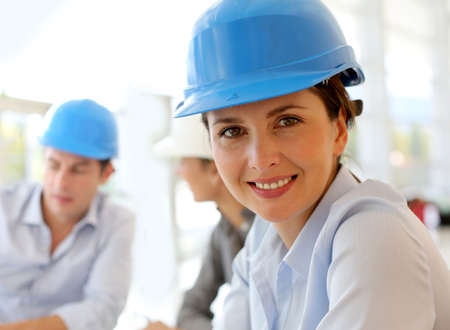 Portrait of attractive architect wearing security helmet photo