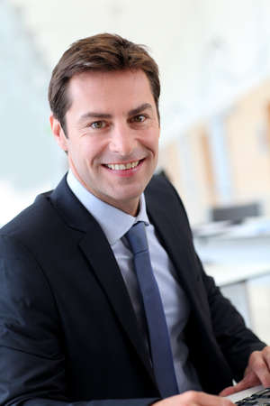 manager: Portrait of businessman wearing dark suit